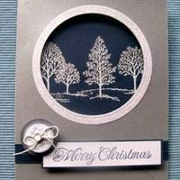handmade Christmas card ... skeleton trees from Lovely as a Tree ... white on black circle framed silver metalic paper ... lovely ... Stampin' Up!