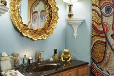 Designer Harry Heissmann expertly deploys bold patterns and cheeky details in his often-eccentric interiors. Here, he has lined the walls of the second-floor powder room in blue leather. A Tony Duquette golden toad, a gilt geranium-leaf mirror by Christopher Spitzmiller, a sunflower-inspired Murano glass ceiling fixture from L'Antiquaire and a roll of orange toilet paper finish off the fanciful room.