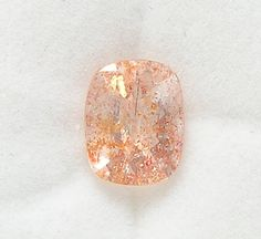 """Tanzania Confetti Sunstone Faceted Gem Stone by FenderMinerals Tanzania Faceted """"emerald cut"""" Rectangle Gem Stone with hematite inclusions Very bright, lots of flash Gem quality Labradorite Feldspar, 100% natural, not enhanced Weight: 2.5 carats"""