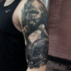 Amazing black and gray tattoo with wolf on shoulder in realism style
