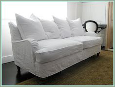 White slipcovers are the best since you can bleach them.  I like the lines on this.