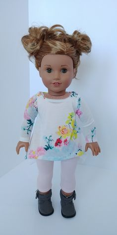 Excited to share the latest addition to my #etsy shop: 18 inch doll clothes. American girl .18 inch doll clothing. Floral tunic and unitard #toys #dollclothes #shirts #white #pink #18inchdolloutfit #18inchdollclothes #dollclothing https://etsy.me/2pJeKaf