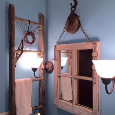 Bathroom mirror, old window, added a mirror, hung with a pulley.