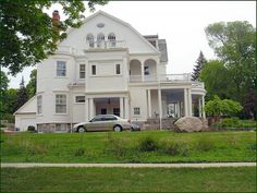restored home, Cadillac, Michigan That's a carriage porch on this side of the house.  Rumor was it had a marble floor ballroom.  The year we moved to Cadillac it was on the market for $10,000.
