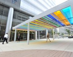 A glass art canopy, designed by British artist Liam Gillick, connects the Centene Plaza office tower to the development's parking garage in Clayton, Missouri.