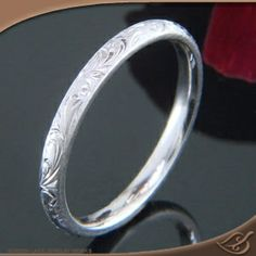 14K WHITE GOLD 2MM SCROLL ENGRAVED BAND  14k White Gold 2mm light comfort fit band with bright cut scroll pattern engraving.  In Stock Item - (1) available in 14k Warm White Gold  $433.00* GREENLAKE JEWELERS