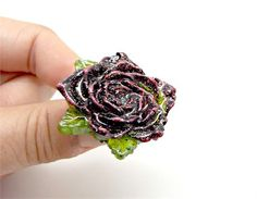 OOAK Handmade Black and Red Rose Ring with Green Leaves and a Silver Plated Adjustable Ring Base   As the ring base is adjustable, the…