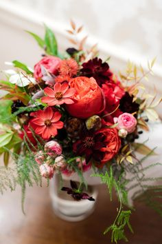 Shades of red and fern bouquet