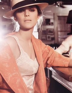 Marion Cotillard in warm colors, a hat, and hazy lighting: French ease as its finest.