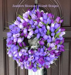 Nothing says Spring, quite like the Tulip. This is a purple with lavender full tulip wreath. It is on a styrofoam base wrapped in purple satin ribbon and then filled with beautiful tulips! I have added a coordinating purple satin ribbon hanger on back. Measuring at 18 x 5.5
