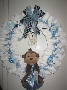 Diaper Wreaths | Diaper Wreath for a Baby Boy Baby Shower - Blue Animal Themed Diaper ...