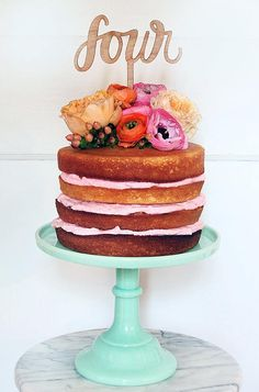 Colorful Naked Wedding Cake with Floral Topper.  MODwedding