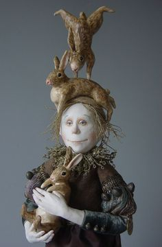 Marlaine Verhelst ~Taking care of rabbits…