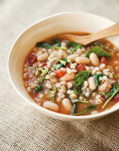 Tuscan Farro Soup with White Beans and Basil | As fall approaches, we can't wait for hearty, warming recipes like this bean and farro soup!