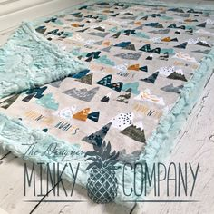 How adorable is this double sided minky blanket!?! The front is designer minky with beautiful abstract mountains and a linen look. The back
