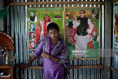 14 year old Mousammat Akhi Akhter stands against a photograph of Bangladesh Prime Minister Sheikh Hasina and her father, founding leader of Bangaldesh, Sheikh Mujibur Rahman in her home August 19, 2015 in Manikganj, Bangladesh. Last year, when she was only 13, Akhi got married a 27 year old man. She had finished 6th grade and wanted to wait until she was older to get married, but she says her parents felt social pressure to marry her young. In June of this year, Human Rights Watch released…