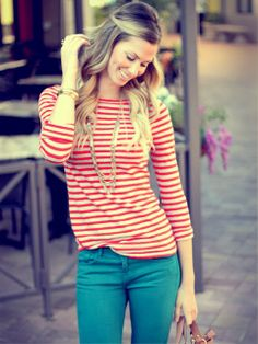 Teal pants with some red stripes, not sure how she managed not to look Christmas-y but she looks great!