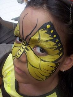 Yellow butterfly face painting