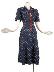 1940s rayon navy & white polka dot suit with red buttons.  Great WWII era patriotic style.
