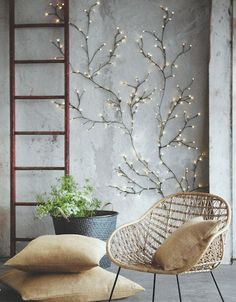 "Roost Twinkling Willow Wall Lights ($100) | Modish. ""Flexible wire construction allows for infinite variation in our Twinkling Willow Wall Lights. Tiny bulbs at the end of floral-tape-wrapped wire illuminate brightly when the branches are plugged in. These completely customizable branches are available in two sizes."""