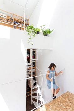 Constanza Chiozza and Pedro Magnasco of Buenos Aires studio CCPM Arquitectos added slivers of glazing and windows wherever possible, to help natural light permeate down through the residence known as PH Lavalleja.