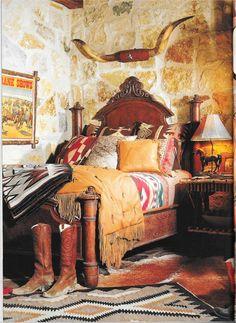Bedroom, Texas limestone construction. Pendleton and Beacon blankets at the Tyler Beard residence near Star, Texas.