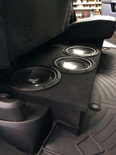 Like many of our customers, the owner of this 2019 Dodge Ram wanted to improve his mobile audio experience without sacrificing the versatility of his vehicle interior. So the team at our West Carrollton store got to work and fabricated this custom low profile subwoofer enclosure to fit underneath his crew cab's rear seat, and they loaded it with four JL Audio 10-inch subwoofers. Our team also paired it with a new SounDigital amplifier, and the combination is literally butt shaking! Custom Car Audio, Custom Cars, West Carrollton, Jl Audio, Toyota Hilux, Hot Wheels Cars, Built In Speakers, Sound Waves, Rear Seat