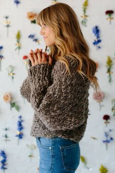 The Be Mine Sweater is the perfect for those beginner knitters who want to try knitting a sweater for the first time! It is made with 3-4 skeins of our chunky soft Spun Cloud yarn! Save this pin and click through for more pattern details and color options! Knitting patterns, knit sweater pattern, easy knitting patterns, knitting patterns for beginners, beginner knitting patterns, easy knit sweater, easy knit top, handspun yarn, bulky yarn, chunky yarn, #knitsweater, #knittop,