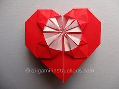 Origami Blossom Heart. This one has a bunch of itty bitty folds! I wouldn't recommend doing it with the normal-sized 15x15cm origami paper. Think BIG!