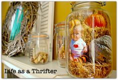 I've seen photos in mason jars before ... these vignettes take the idea to a whole new level!