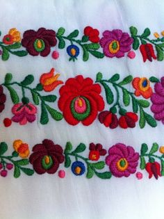 Traditional Hungarian embroidery on an inherited shawl. Lots of satin stitch used.