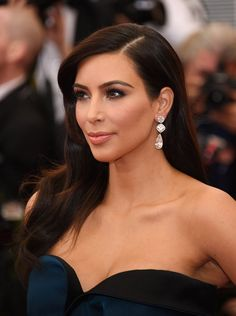Pin for Later: 22 of the Most Memorable Looks From Met Galas Past Kim Kardashian Of all the looks on the 2014 Met Gala red carpet, Kim fell on the tamer side of the spectrum with sideswept waves and glossy lips.