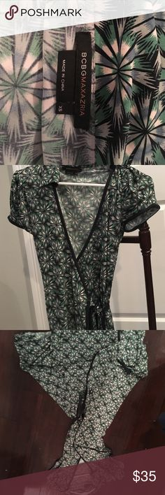 Flowy BCBG wrap dress, great for travel! Empire waist functional wrap dress can be adjusted tighter or looser. Can be tied in front or back, great condition! BCBGMaxAzria Dresses Midi