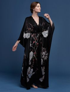 PRINTED SILK SATIN V NECK WRAP BLACK RED CHERRY BLOSSOM Delicate and feminine, our cherry blossom artwork is a celebration of nature. Eye-catching blossoms are interspersed among the hand-drawn birds and pastel-hued foliage to create this alluring print. Enjoy printed silk satin v neck wrap black red cherry blossom.