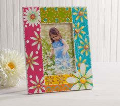 """What could be more fun than to create and enjoy a """"daisy-filled"""" photo frame? Using the Plaid Daisy stencil as a guide to paint daisies is only the beginning. Adding decorative dots and lines to shade and embellish just adds to the fun of this project! #plaid crafts #crafts #folkart #stencils"""
