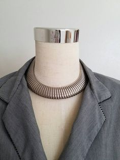 Gas Pipe Silver Collar Necklace Omega Chain Semi Stretch Gaspipe Choker Les Bernard Style  Gorgeous flexible gas pipe collar choker in a shiny chrome finish measures 17.5 inches long and just over 1 inch wide.  This unsigned beauty is in the style of Les Bernard. Push closure.  Condition is very good with very little surface wear or scratches.  No cost shipping in the USA - standard mail. If you need it sooner please ask for quote.  If you like this beauty you can find a matching bracelet…