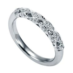 Genesis Designs WB5514W44JJ Wedding Ring  14K white gold victorian style wedding band with round brilliant diamonds pave set inside of marquise shapes.