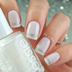 Looking for your perfect wedding day manicure? Use a white sheer essie shade like 'marshmallow' and a stripe of silver glitter to seal the deal.