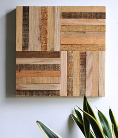 These square wood art panels can be combined with additional panels to created your own design. Each piece is handmade from reclaimed wood and comes with hanging hardware. Dimensions: 12 x 12 x