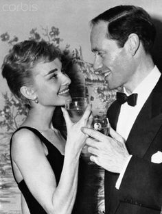 Audrey Hepburn and Mel Ferrer Having a Drink Together