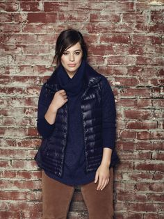 Addition Elle plus size down-filled vest with lurex cowl neck sweater and corduroy pant.