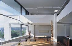 Two Modern Villas Hidden by a single Facade: MIKI 1 House - https://freshome.com/2012/02/16/two-modern-villas-hidden-by-a-single-facade-miki-1-house/