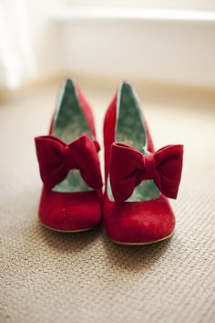 They're red. They have bows. Xx