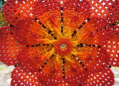 La joyería hecha con cuentas de chaquira es un elemento muy importante en la indumentaria de la etnia indígena Huichol. La usan tanto mujeres como hombres; collares, aretes y pulseras, con motivos diversos de la flor hikuri mejor conocida como peyote, medicina sagrada del pueblo Wixarika o Huichol.