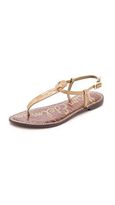 Sam Edelman Gigi Patent T Strap Sandals | These glossy faux-patent leather sandals are detailed with an adjustable ankle strap and an embossed footbed. Synthetic sole. Fabric: Patent. Imported, China. This item cannot be gift-boxed.
