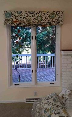 These roman shades are made to resemble a traditional roman shade, but they don't raise or lower. We make roman shades, get a free consult: 419-381-2700