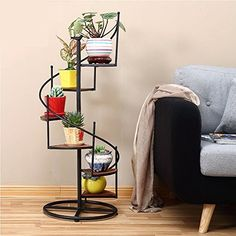 If you were looking for hanging gardens, take a look below Indoor Plant Shelves, Garden Shelves, House Plants Decor, Plant Decor, Minimal House Design, Diy Cardboard Furniture, Metal Plant Stand, Plant Stands, Iron Decor