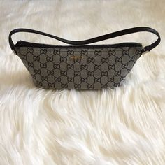 Small Gucci purse 100% Gucci. Very small easy to carry around purse. Great for a night out. Grey and black . No pockets. Silver hardware. Never used, great condition. Price is more flexible through mercari app or cash app❤️   ❌ PLEASE DO NOT ASK FOR MY LOWEST, MAKE AN OFFER INSTEAD (button below) ❌ SERIOUS BUYERS ONLY  ❌ NO TRADES Gucci Bags