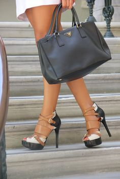 Fabulous shoes and quality handbag speak volumes about a woman's style even if her wardrobe consists of jeans and a simple tee (from www.thesimplyluxuriouslife.com)