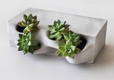 3D printed concrete planter brick by Emerging Objects.
